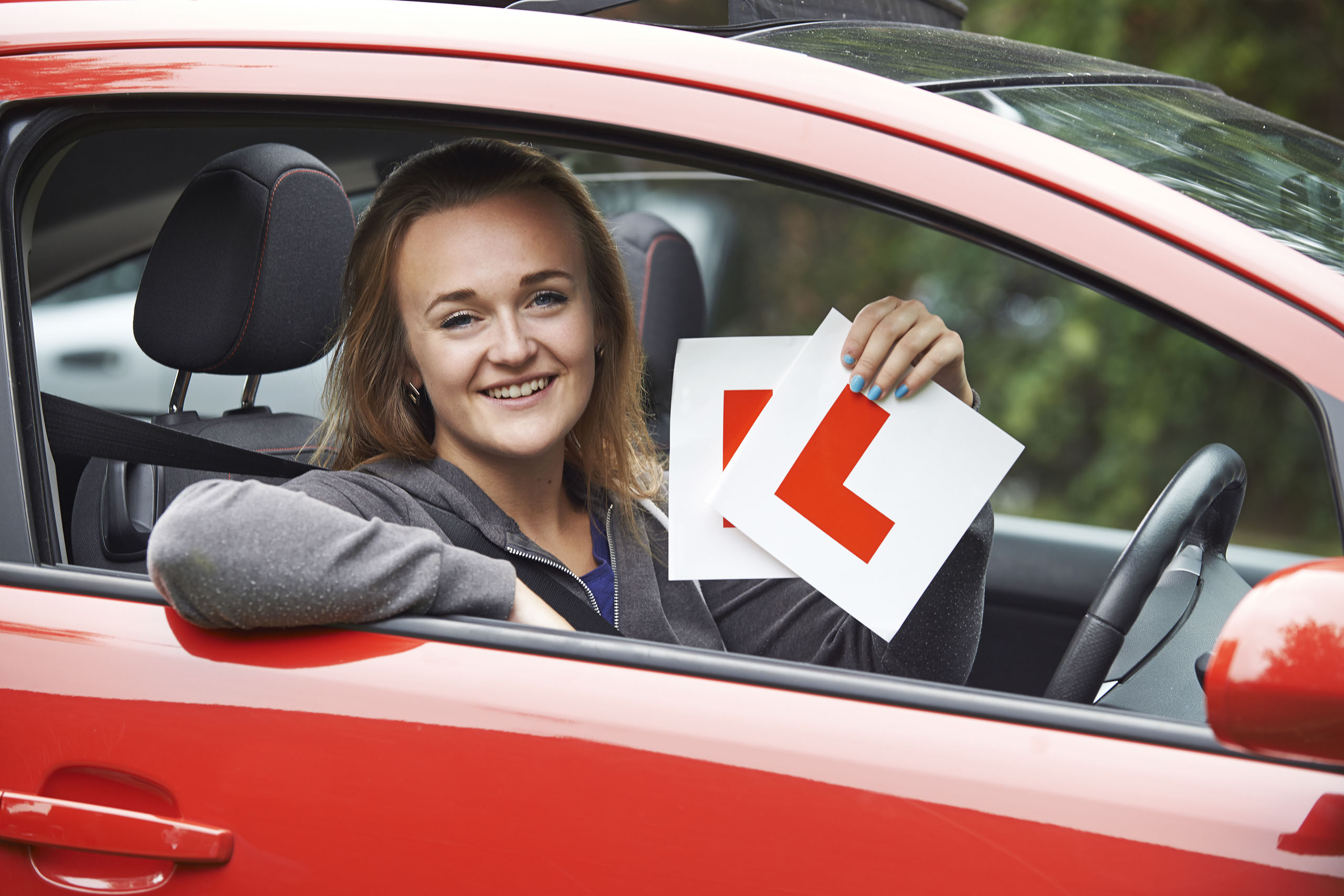 Teenage Girl Passing Driving Exam