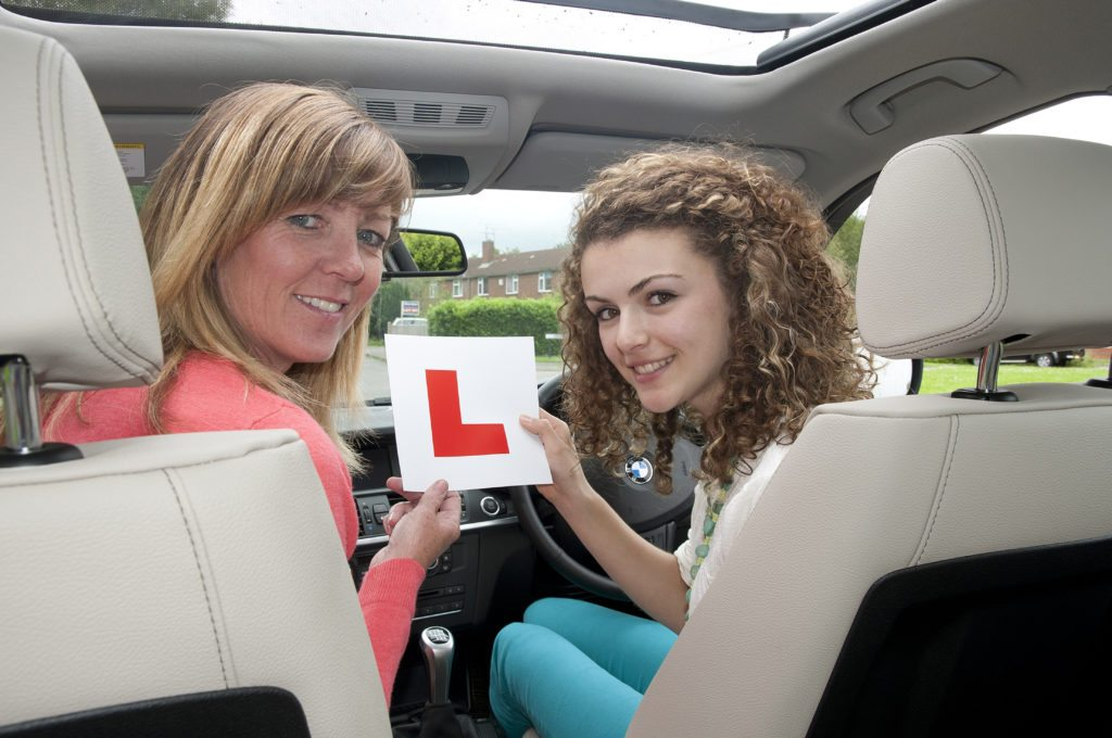 driving-lessons-with-a-female-instructor-adobestock-51037113-1-1024x680